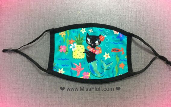 Cute purrmaid kitty face masks designed by artist Miss Fluff!